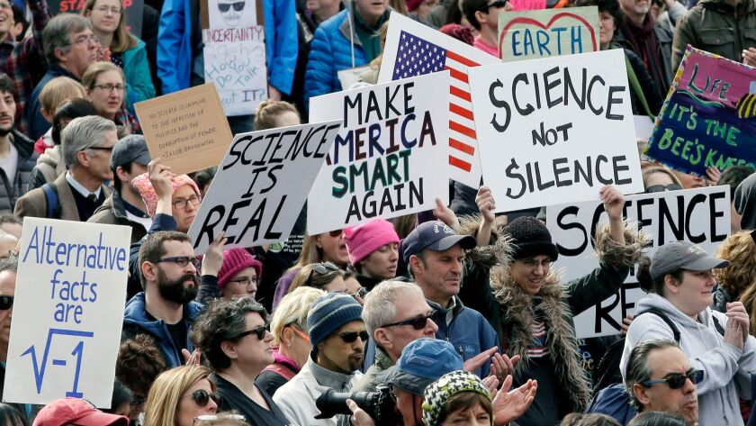 Members of the scientific community and their supporters at a rally in Boston at February. The American College of Physicians is urging its members to participate in the March for Science on Saturday.