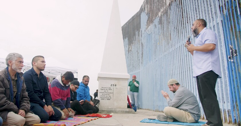 """Imam Wesley Lebron leading the supplication at the US/ Mexico border at Friendship Park in Tijuana. From the film """"A Prayer Beyond Borders"""" Directed by Ala'Khan & Reynaldo Escoto"""