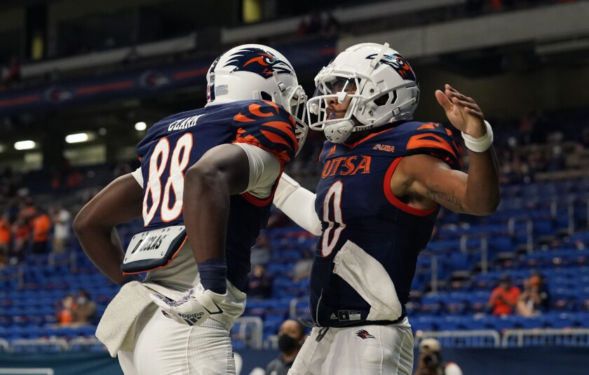 UTSA quarterback Frank Harris (0) celebrates with teammate De'Corian Clark (88) after running for a touchdown against Stephen F. Austin during the first half of an NCAA college football game, Saturday, Sept. 19, 2020, in San Antonio. (AP Photo/Eric Gay)