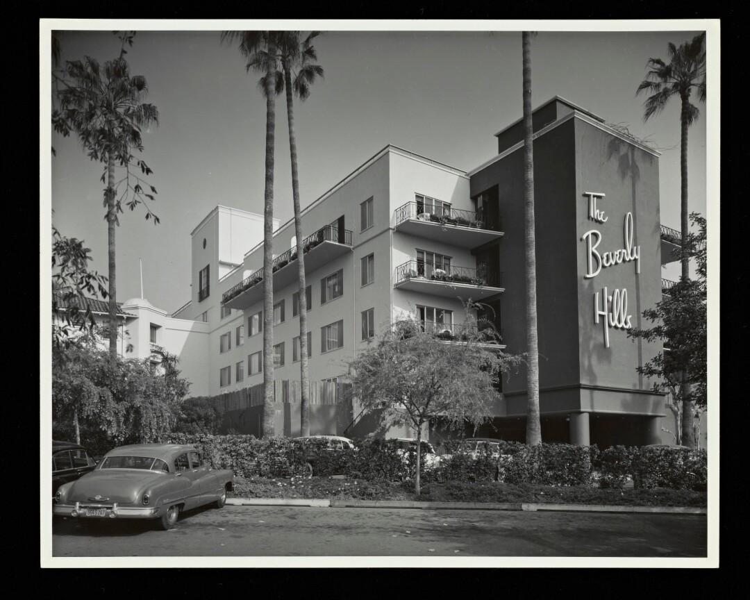 A black-and-white photo shows the Modern wing of the Beverly Hills Hotel with the hotel's name on the façade.
