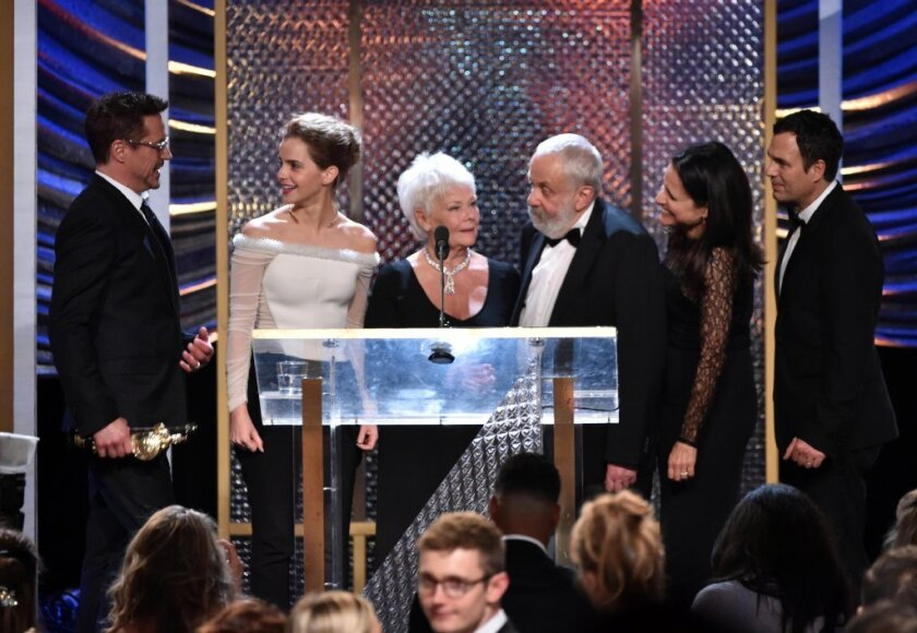 The winners of the BAFTA Los Angeles' Britannia Awards gather on stage at the Beverly Hilton Hotel on Thursday evening. From left are Robert Downy Jr., Emma Watson, Judi Dench, Mike Leigh, Julia Louis-Dreyfus and Mark Ruffalo.