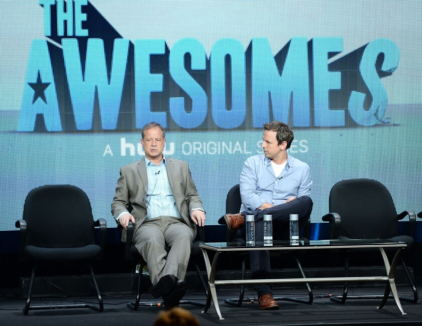 BEVERLY HILLS, CA - JULY 31: Co-Creator/Executive Producer/Writer Michael Shoemaker (L) and Co-Creator/Writer/Actor Seth Meyers speak onstage during the 'The Awesomes' portion of the Hulu 2013 Summer TCA Tour at The Beverly Hilton Hotel on July 31, 2013 in Beverly Hills, California.