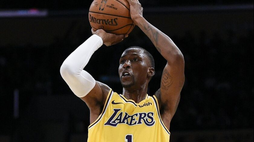 Los Angeles Lakers guard Kentavious Caldwell-Pope attempts a shot during the first half of an NBA pr