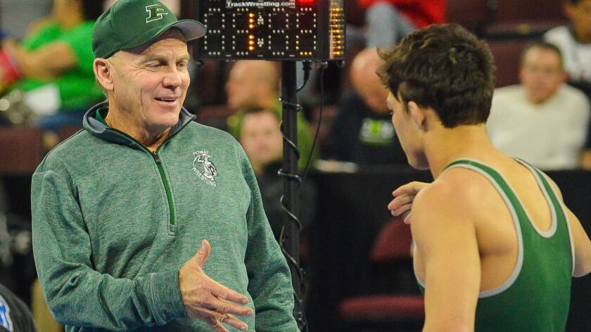 Poway wrestling coach Wayne Branstetter during a match this past season.