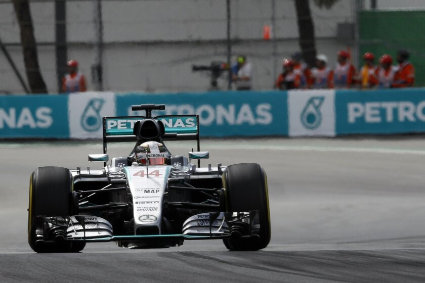 Mercedes driver Lewis Hamilton of Britain drives his car during the third practice session for the Formula One Mexico Grand Prix auto race at the Hermanos Rodriguez racetrack in Mexico City, Saturday, Oct. 31, 2015. (AP Photo/Moises Castillo)