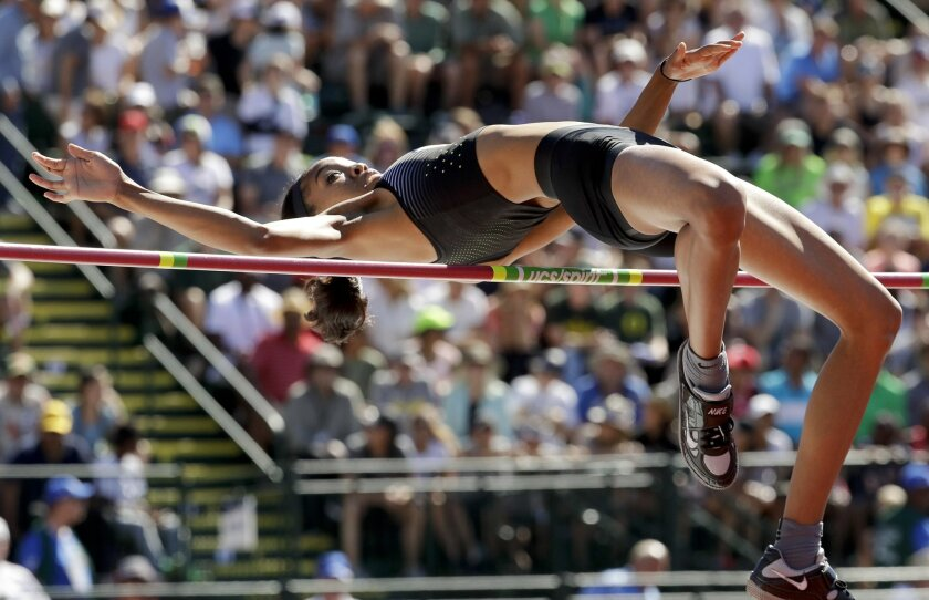 FILE - In this July 3, 2016, file photo, Vashti Cunningham clears the bar during the women's high jump final at the U.S. Olympic Track and Field Trials in Eugene Ore. Of the 50 track and field athletes who've qualified so far for the Rio Games, 35 will be making their Olympic debut. Sounds like a l