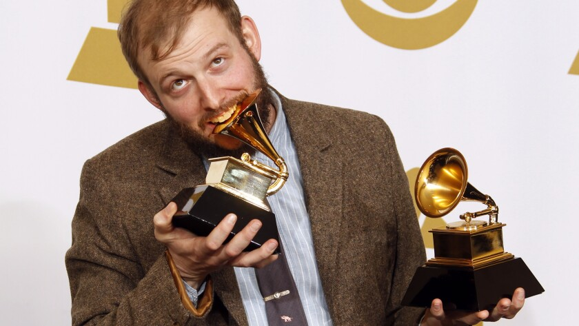 "Bon Iver frontman Justin Vernon with his two Grammys in 2012 for a self-titled album. His latest album is ""22, a Million."""