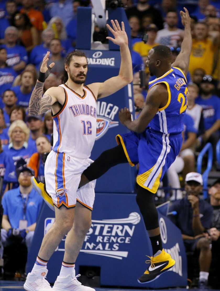 DELETES REFERENCE TO SUSPENSION - In this Sunday, May 22, 2016 photo, Golden State's Draymond Green's leg is between the legs of Oklahoma City's Steven Adams (12) during Game 3 of the Western Conference NBA basketball finals in Oklahoma City. Green's kick to Steven Adams' groin could complicate Golden State's chance to repeat as NBA champion. The Warriors trail the Thunder 2-1, and if Green is suspended the Warriors will lose plenty of All-Star muscle for Game 4 on Tuesday night. (Bryan Terry/The Oklahoman via AP) LOCAL STATIONS OUT (KFOR, KOCO, KWTV, KOKH, KAUT OUT); LOCAL WEBSITES OUT; LOCAL PRINT OUT (EDMOND SUN OUT, OKLAHOMA GAZETTE OUT) TABLOIDS OUT; MANDATORY CREDIT