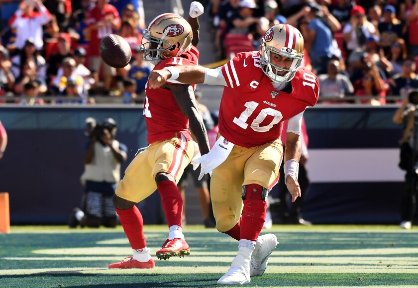 San Francisco 49ers quarterback Jimmy Garoppolo spikes the football after sneaking for a touchdown against the Rams.