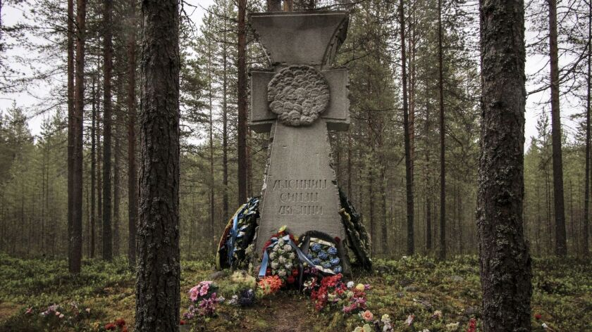 A monument memorializes Ukrainians who were executed at Sandarmokh in Karelia.