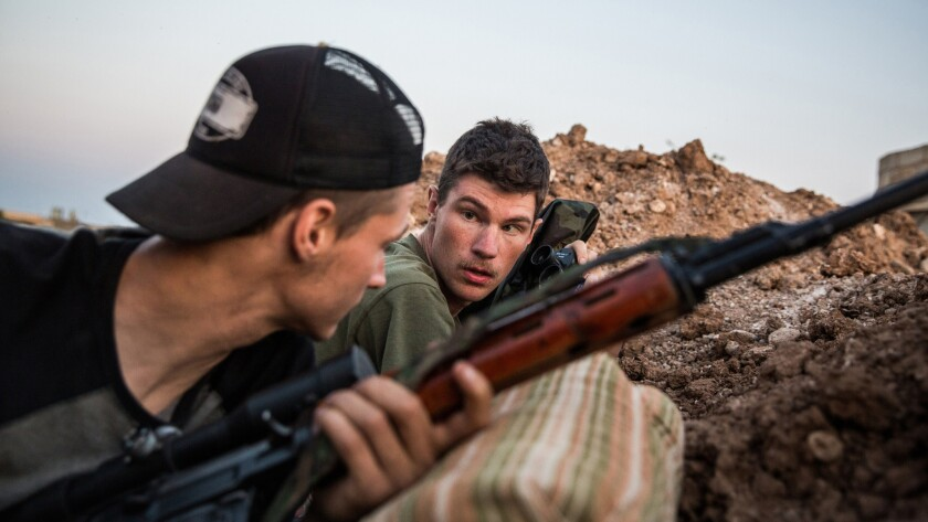 Levi Shirley, right, and another American volunteer during a clash with Islamic State fighters near Tal Tamr, Syria.
