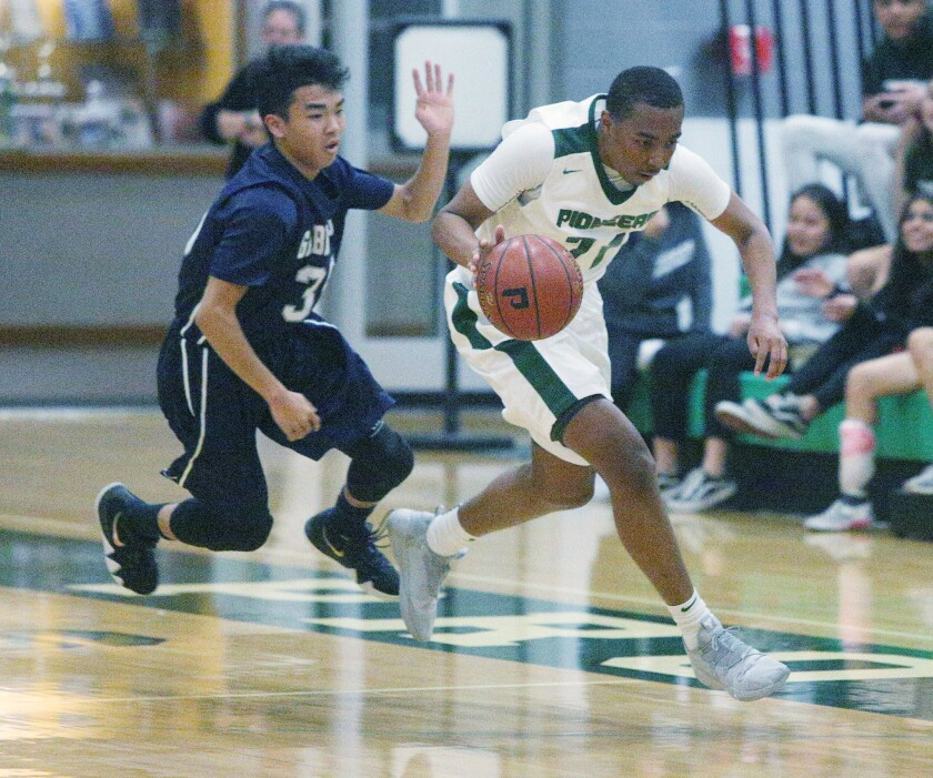 Providence's A'Jahni Levias, right, seen here in a file photo, scored 13 first half points for Providence against Flintridge Prep on Tuesday but was pulled in the third quarter following a hard foul.