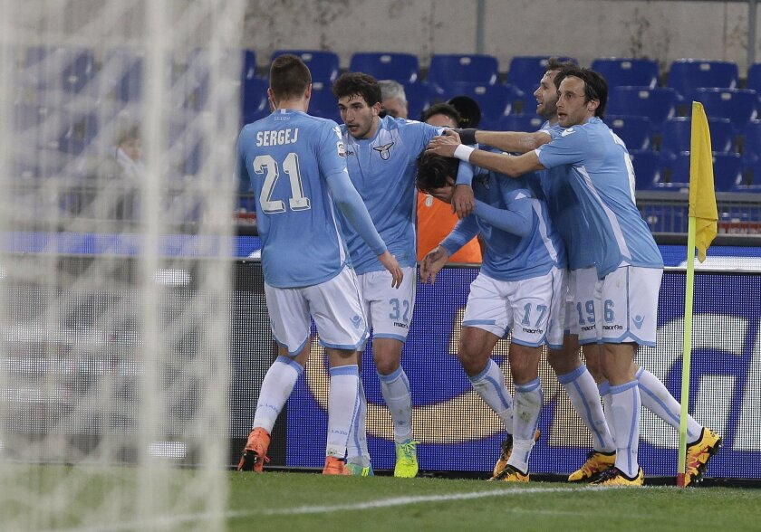 Lazio's Alessandro Matri, center, celebrates with teammates after scoring during a Serie A soccer match between Lazio and Hellas Verona  at Rome's Olympic stadium, Thursday, Feb. 11, 2016. (AP Photo/Alessandra Tarantino)