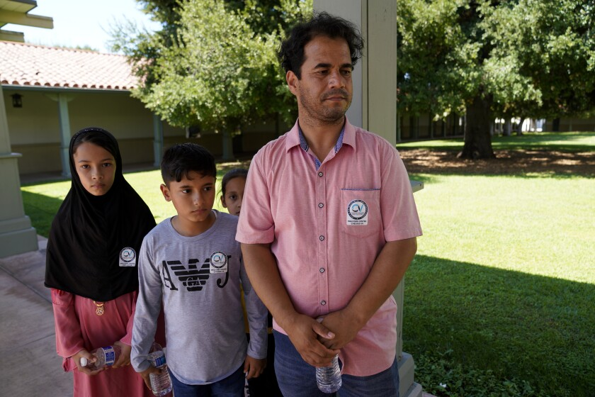 Mohammad Faizi spoke about the difficulty of gaining access to enter Kabul airport with his wife and their five children.