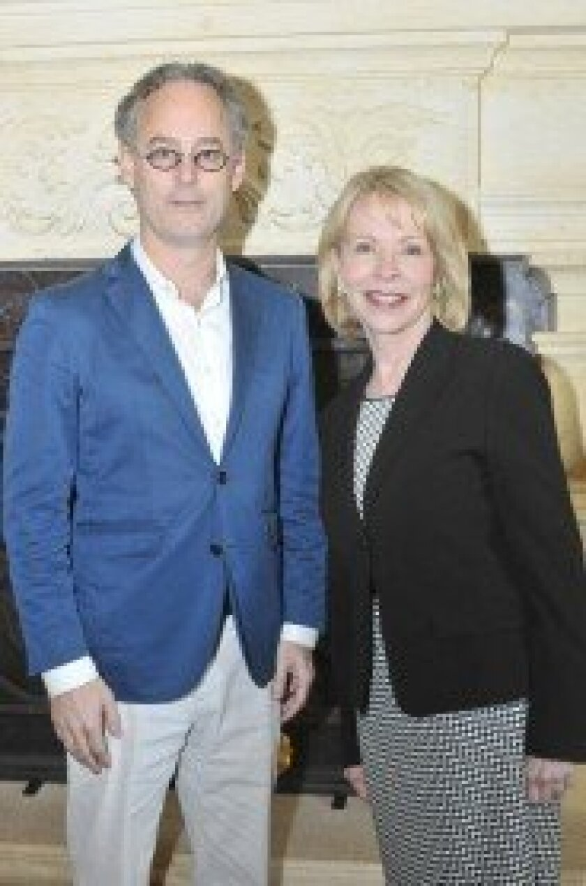 Author Amor Towles with Chapter leader Gayle Allen of Northern Trust. Photo/McKenzie Images