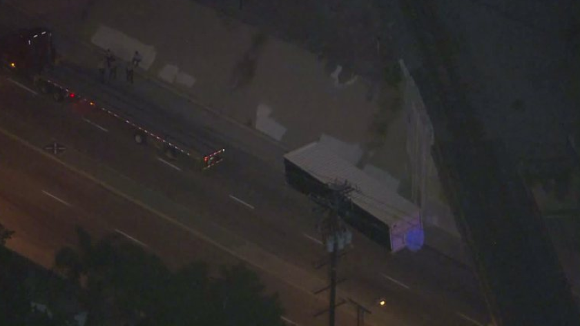 A man was crushed Tuesday night after a shipping container fell off a moving big rig in Carson, authorities said.