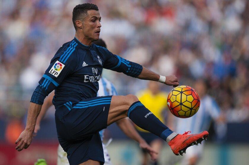 Real Madrid's Cristiano Ronaldo from Portugal, controls the ball, during a Spanish La Liga soccer match between Malaga and Real Madrid at La Rosaleda stadium in Malaga, Spain, Sunday, Feb. 21, 2016. (AP Photo/Daniel Tejedor)