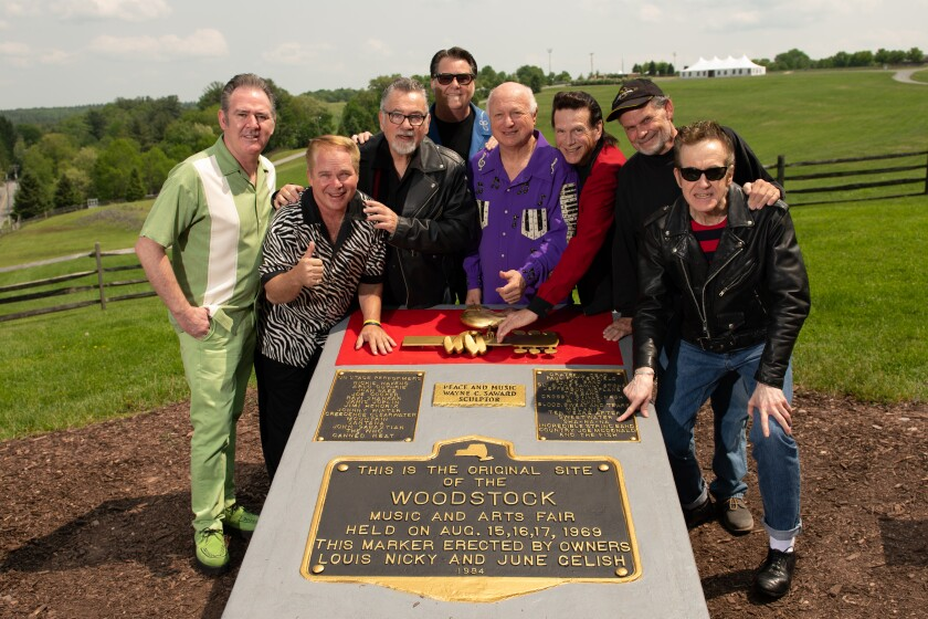 Sha Na Na returned on June 1 to the site of the 1969 Woodstock festival for a performance and tour of the grounds and museum at Bethel Woods Center for the Arts in New York. Pictured from left are band members Ty Cox, Michael Brown, Jocko Marcelino, Tim Butler, Screamin' Scott Simon, Randy Hill, Museum at Bethel Woods curator Wade Lawrence and Donny York. York, Marcellino and Simon are all co-founders of the 50-year-old Sha Na Na.