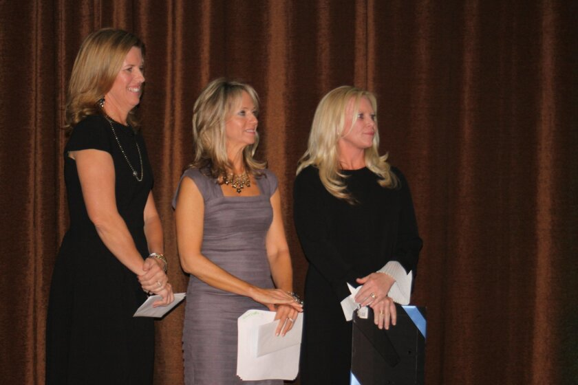 2014 Jewel Ball co-chair Melinda Mahony, chair Susie Piegza and co-chair Cari Massaad, stand ready to present checks to san Diego nonprofits.