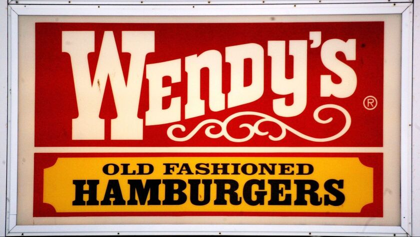 Wendy's, which touts its old-fashioned burgers, is rolling out self-service kiosks where customers can order food.