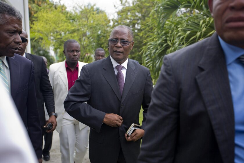Haiti's provisional President Jocelerme Privert arrives to give his first press conference since a he was elected interim leader, at the National Palace in Port-au-Prince, Haiti, Friday, Feb. 19, 2016. Privert will lead the country until the postponed presidential election runoff set for April, wit