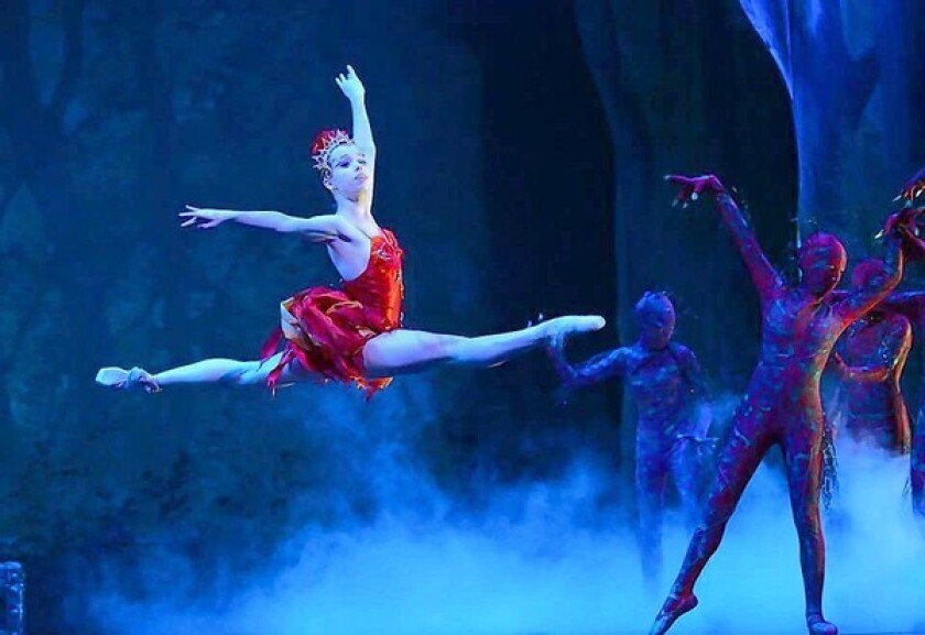 """Michelle Lemburg, as the firebird, flies through a forest of monsters in """"Firebird"""" at Irvine Barclay Theatre."""