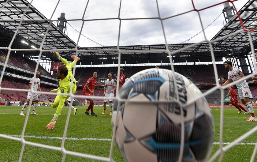 Union's Marvin Friedrich, third left, scores the opening goal during the German Bundesliga soccer match between 1. FC Cologne and 1. FC Union Berlin in Cologne, Germany, Saturday, June 13, 2020. The German Bundesliga is the world's first major soccer league to resume after a two-month suspension because of the coronavirus pandemic. (AP Photo/Martin Meissner, Pool)