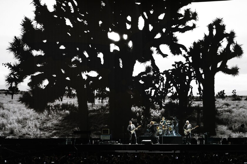 Irish rock band U2 pulled into San Diego for the final performance of The Joshua Tree tour at SDCCU stadium paying homage to their breakthrough last 1980s album that catapulted them to stardom. (John Gastaldo/San Diego Union-Tribune)