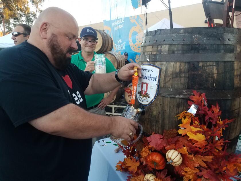 La Mesa Mayor Mark Arapostathis taps the keg at the 2018 La Mesa Oktoberfest.