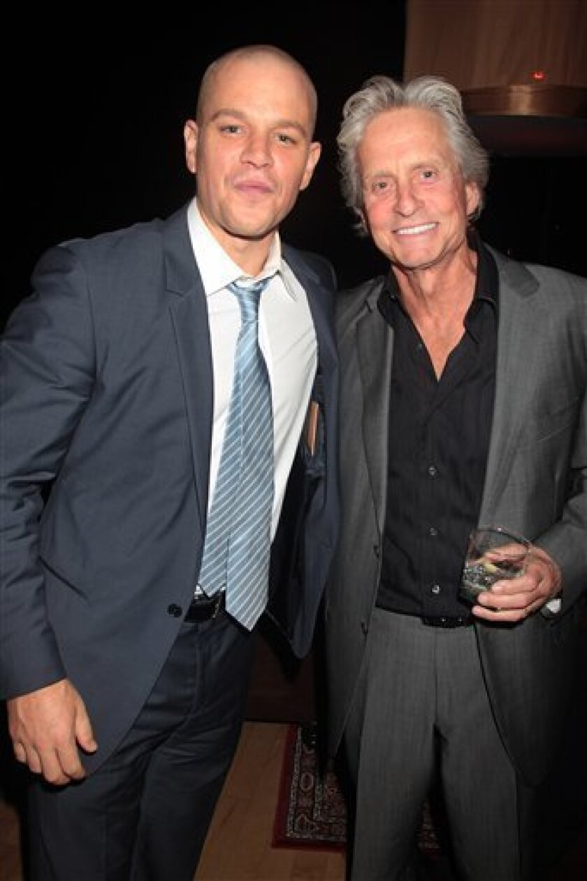 """FILE - In this Sept. 7, 2011 file photo, actors Matt Damon, left, and Michael Douglas are shown at the after party for the film """"Contagion,"""" in New York. Douglas and Damon will star as Liberace and Scott Thorson, Liberace's younger live-in lover for HBO's its upcoming biopic of legendary pianist, titled """"Behind the Candelabra"""". (AP Photo/Starpix, Dave Allocca)"""