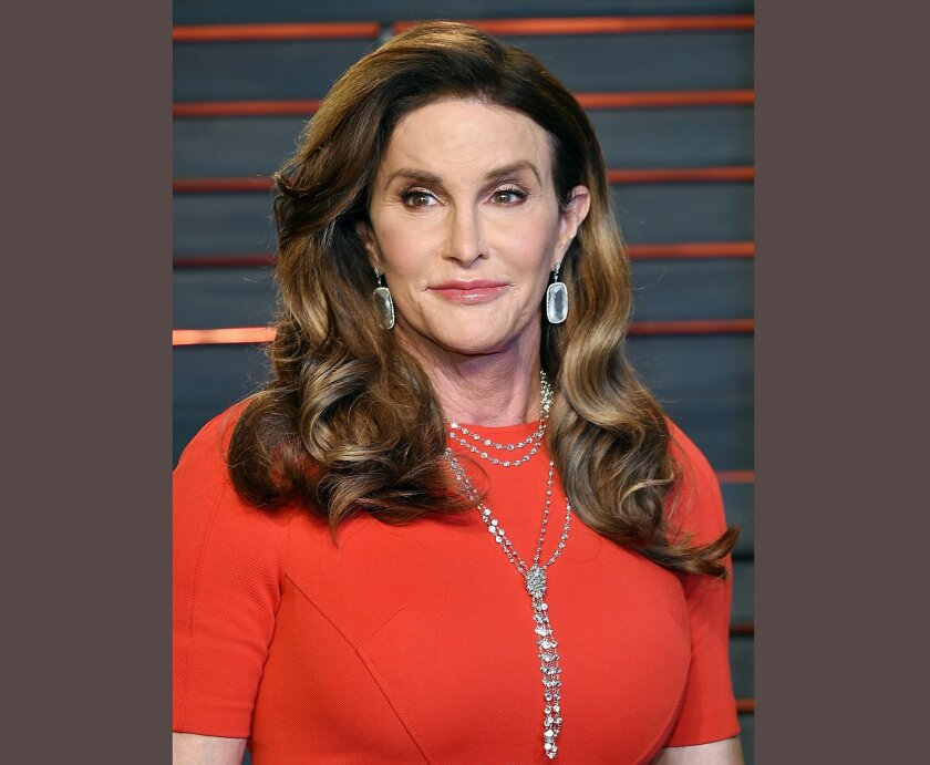 FILE - In this Feb. 28, 2016 file photo, Caitlyn Jenner attends the Vanity Fair Fair Oscar Party in Beverly Hills, Calif. Jenner will mark the 40th anniversary of her gold-medal Olympic win in the decathlon with a cover story in Sports Illustrated. The magazine featuring Jenner on the cover hits ne