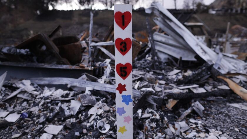 A space marker was all that remained of a mobile home in Agoura Hills destroyed in the Woolsey fire. California residents have until Friday to apply for federal aid to help with losses suffered in a string of wildfires in November.