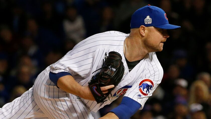 Chicago Cubs starting pitcher Jon Lester throws during the first inning of Game 5 of the Major League Baseball World Series against the Cleveland Indians.