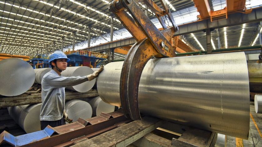 China's economic growth held steady in the latest quarter despite a tariff war with Washington. Above, aluminum products at a factory in Nanning in China's Guangxi Zhuang Autonomous Region on April 10.