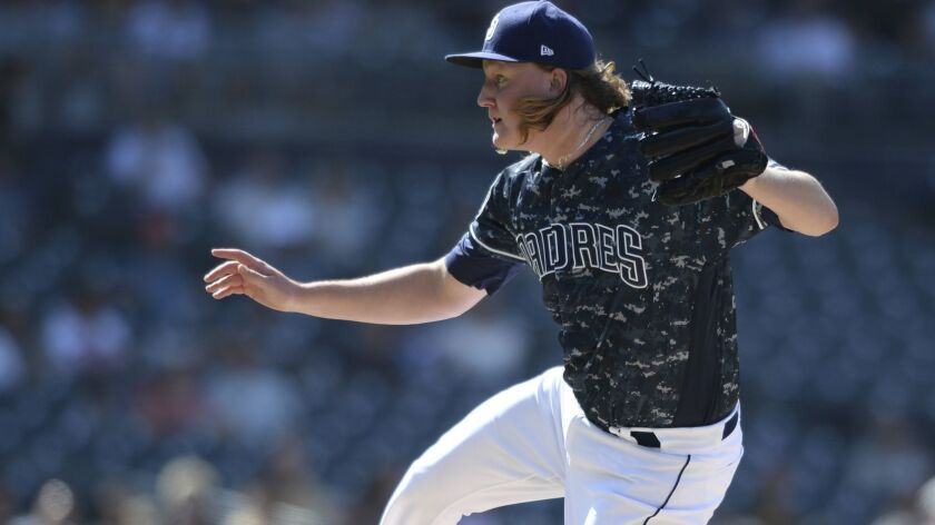 San Diego Padres relief pitcher Trey Wingenter works against a Arizona Diamondbacks batter during th