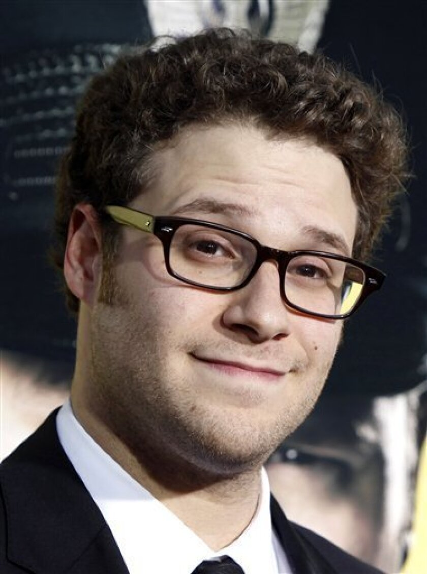 """FILE - In this April 6, 2009 file photo Seth Rogen arrives at the premiere of """"Observe and Report"""" in Los Angeles.  (AP Photo/Matt Sayles, file)"""