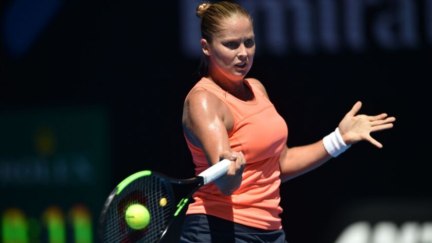 Shelby Rogers returns a shot against Simona Halep during their women's singles match on Monday at the Australian Open.