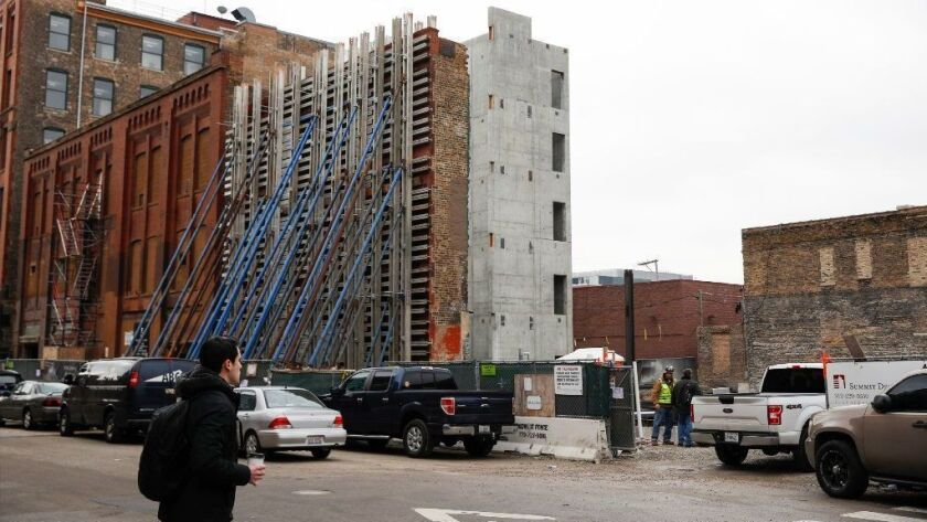 Mondelez International plans to move its global headquarters from Deerfield to Chicago's Fulton Market neighborhood in April 2020. The new five-story building at 905 West Fulton Market is under construction.