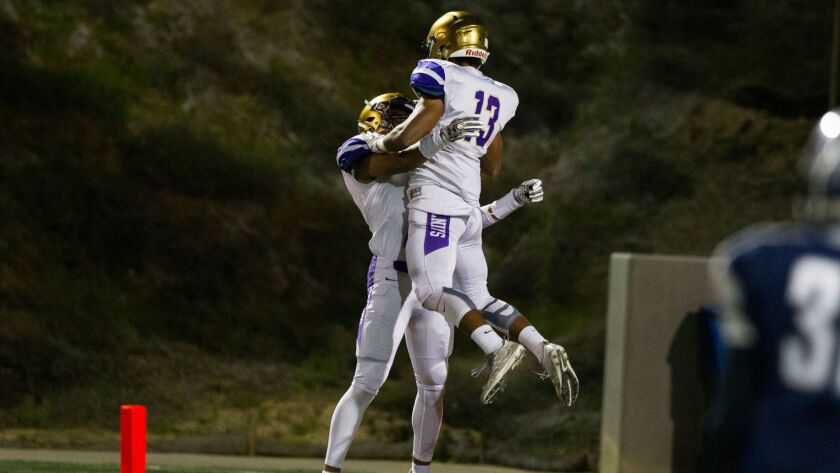 St. Augustine wide receiver Tariq Thompson (13) celebrates a touchdown in the first quarter.