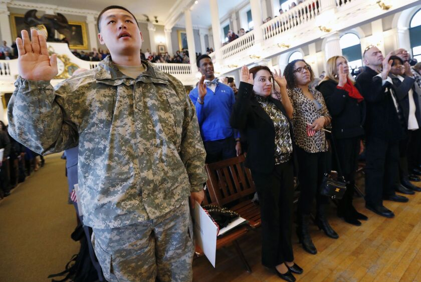 Massachusetts National Guardsmen Dongmin Yang, a South Korean immigant, takes the oath of U.S. citizenship during a naturalization ceremony at Faneuil Hall in Boston last month. The House measure considered Thursday seeks to allow some immigrants in the U.S. illegally to join the military.
