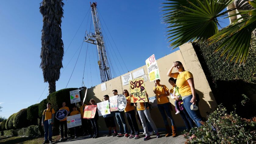 Community activists protest at a drilling site at Jefferson Boulevard and Budlong Avenue in 2015.