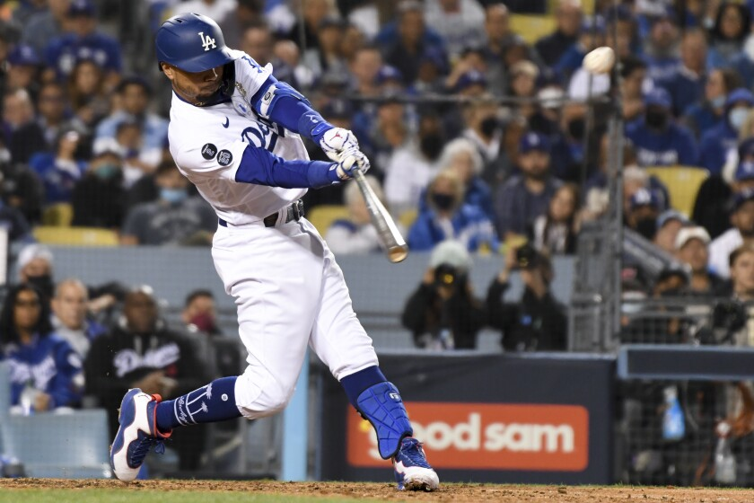 Mookie Betts hits a two-run home run during the fourth inning of the Dodgers' 7-2 win over the San Francisco Giants.
