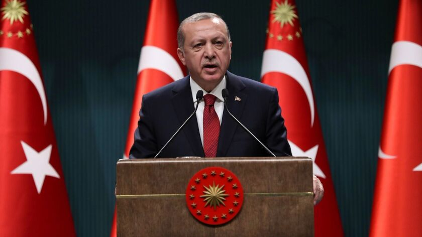 Turkish President Recep Tayyip Erdogan speaks at a news conference in Ankara on April 18, 2018.