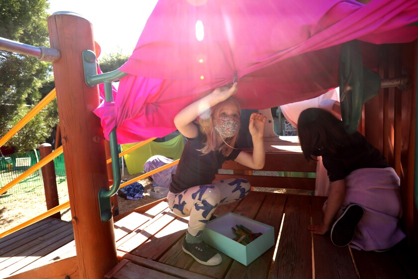 Two kindergarten students build a fort while attending Kigala Preschool