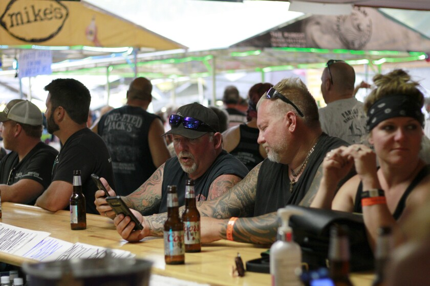 People at a bar during the Sturgis Motorcycle Rally in Sturgis, S.D.
