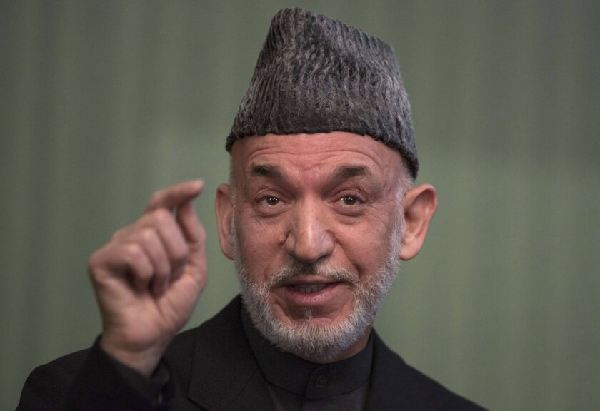 Then-President of Afghanistan Hamid Karzai addresses a news conference at the Presidential Palace in Kabul on January 25, 2014.