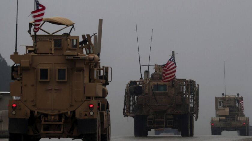 A line of US military vehicles in Syria's northern city of Manbij on Dec. 30, 2018.
