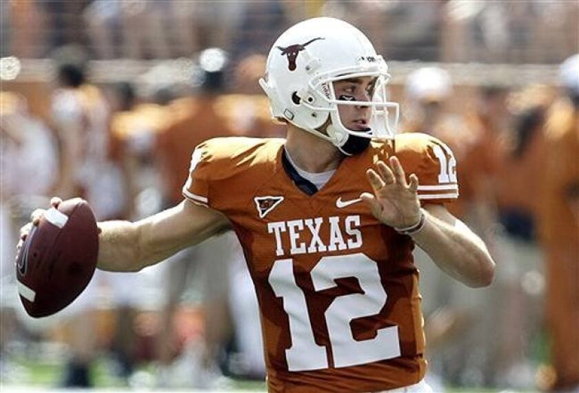 Texas quarterback Colt McCoy faced some heat from Nebraska defensive tackle Ndamukong Suh during their game last week. Both players are finalists for the 2009 Heisman Trophy, which will be announced Saturday.