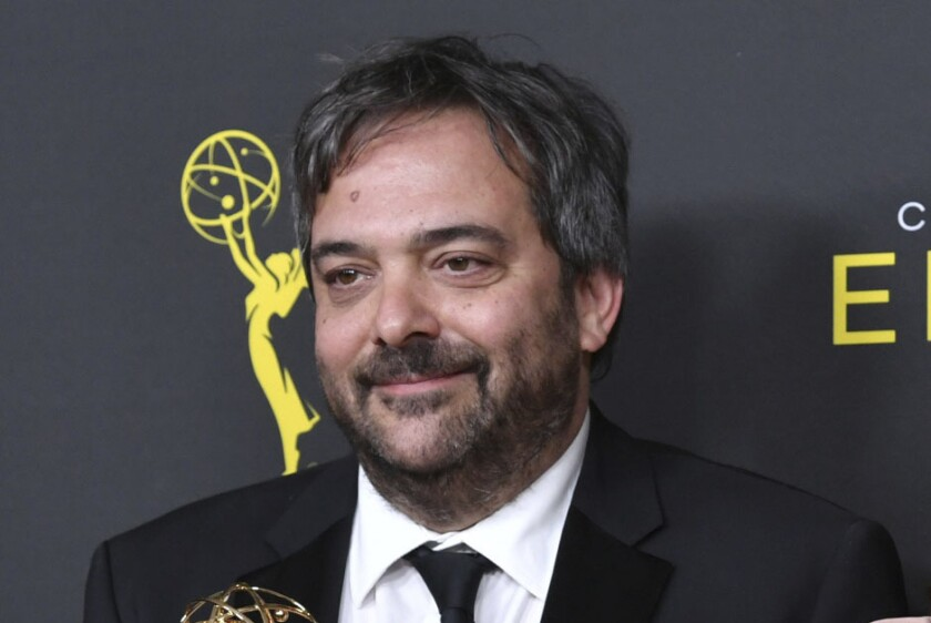 """FILE - Adam Schlesinger, winner of the awards for outstanding original music and lyrics for """"Crazy Ex Girlfriend,"""" in the press room at the Creative Arts Emmy Awards in Los Angeles on Sept. 14, 2019. An eclectic lineup of musicians is turning out for an online tribute to Adam Schlesinger, the prolific songwriter who died a year ago of COVID-19. Members of the Monkees, R.E.M., Dashboard Confessional and the Black Keys are expected, along with Sean Ono Lennon, Courtney Love, Drew Carey and Rachel Bloom. The 'musical celebration' will premiere May 5 on the Rolling Live platform. (Photo by Richard Shotwell/Invision/AP, File)"""