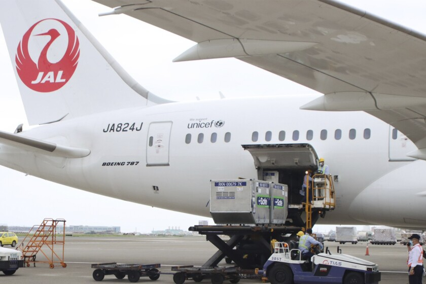 FILE - In this June 4, 2021, file photo released by the Taiwan Centers for Disease Control, workers unload vaccines from a plane from Japan at the airport at the international Airport in Taoyuan, Taiwan. Japanese Foreign Minister Toshimitsu Motegi said Tuesday, July 6, 2021, that some 1.1 million doses of AstraZeneca vaccine is set for shipment on Thursday as the self-governing island, scrambles to get vaccine to fight its worst outbreak of the pandemic. (Taiwan Centers for Disease Control via AP, File)